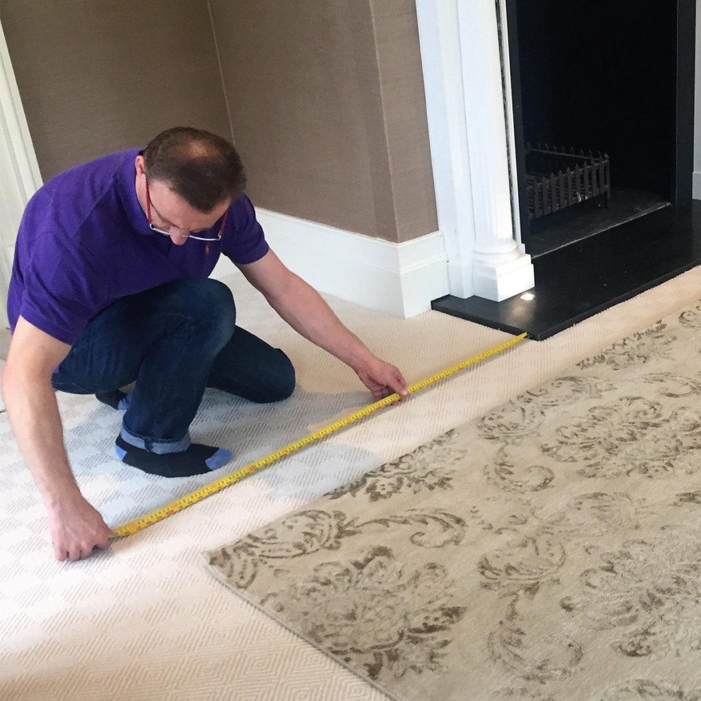 Classic Rug Care | Richard checking installation accuracy