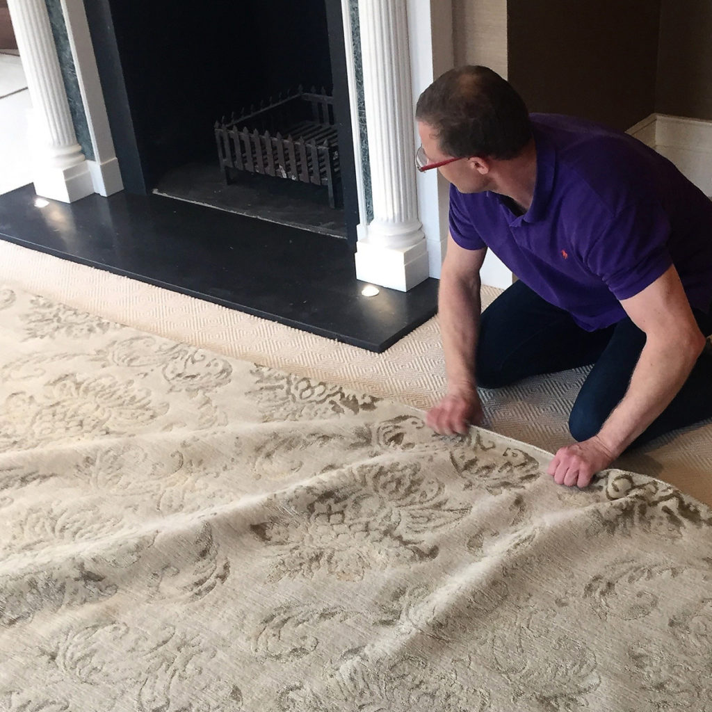Classic Rug Care | Richard nudging to perfection