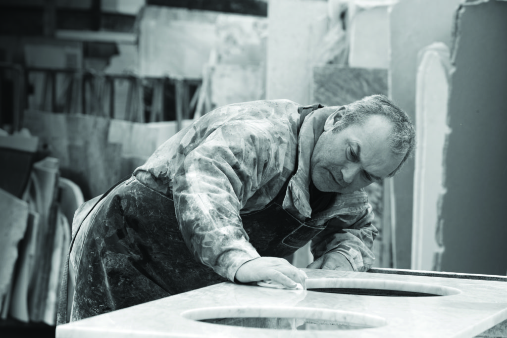 Artisans of Devizes | In the factory honing and polishing a stone double-basin worktop before delivery.